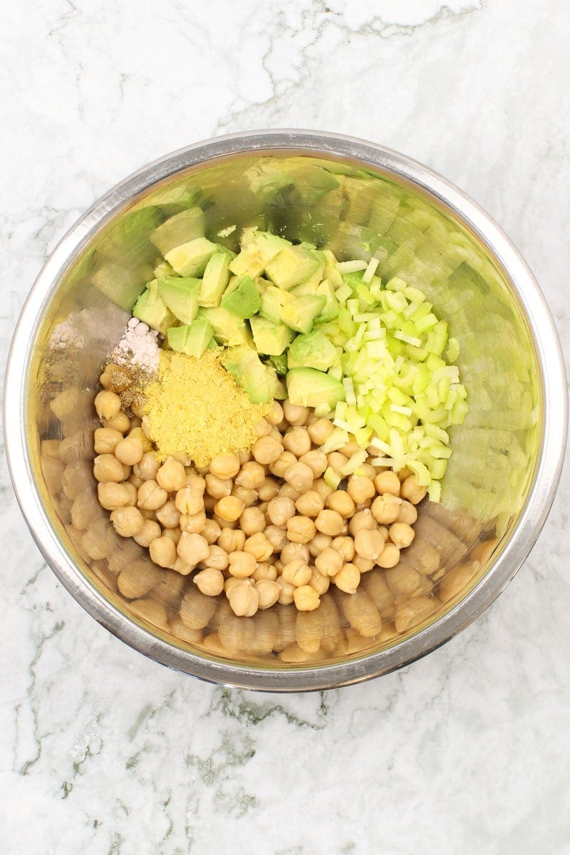 chickpeas, avocado, nutritional yeast, diced celery in a bowl