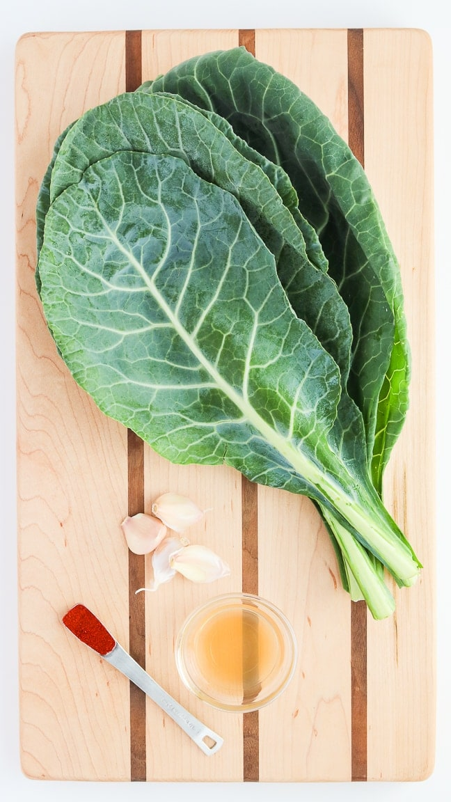 cutting board with collard greens, smoked paprika, garlic and apple cider vinegar.