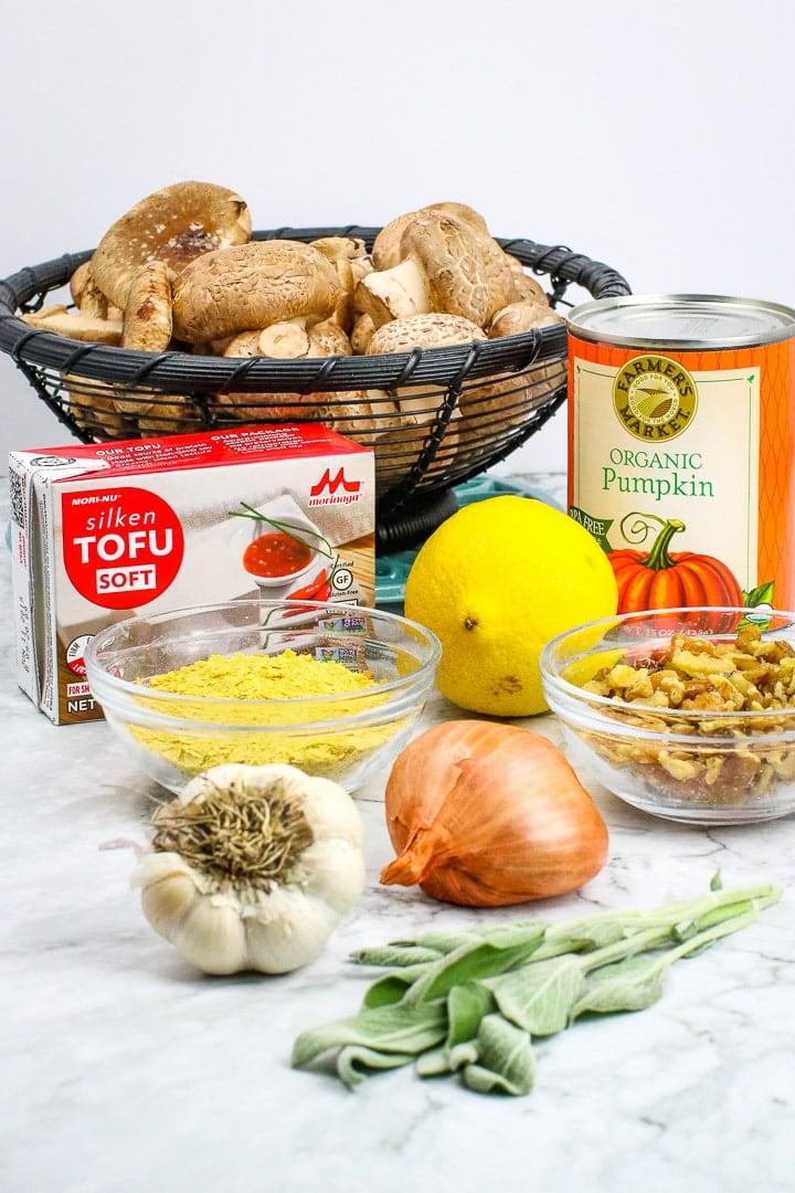 Vegan pumpkin sauce ingredients: silken tofu, pumpkin puree, nutritional yeast, lemon. Optional ingredients: shitake mushrooms, garlic, shallots, fresh sage & walnuts.