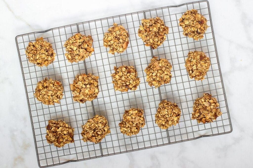 vegan oatmeal cookies on a wire rack on white marble