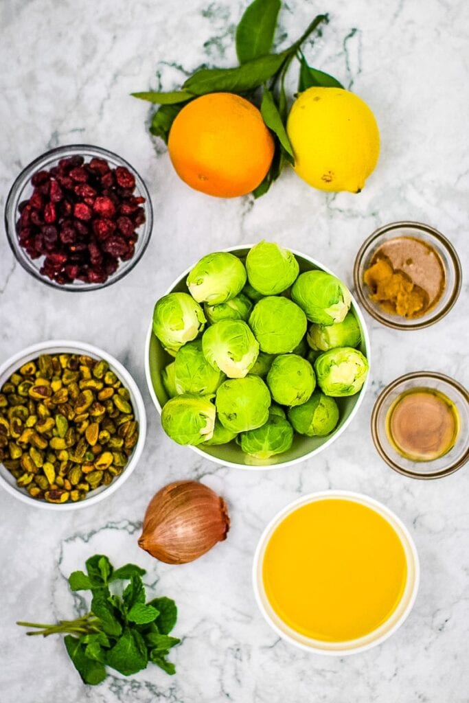 Ingredients: brussels sprouts, orange, lemon, miso paste, almond butter, shallot, maple syrup, dried cranberries, fresh mint and pistachios.