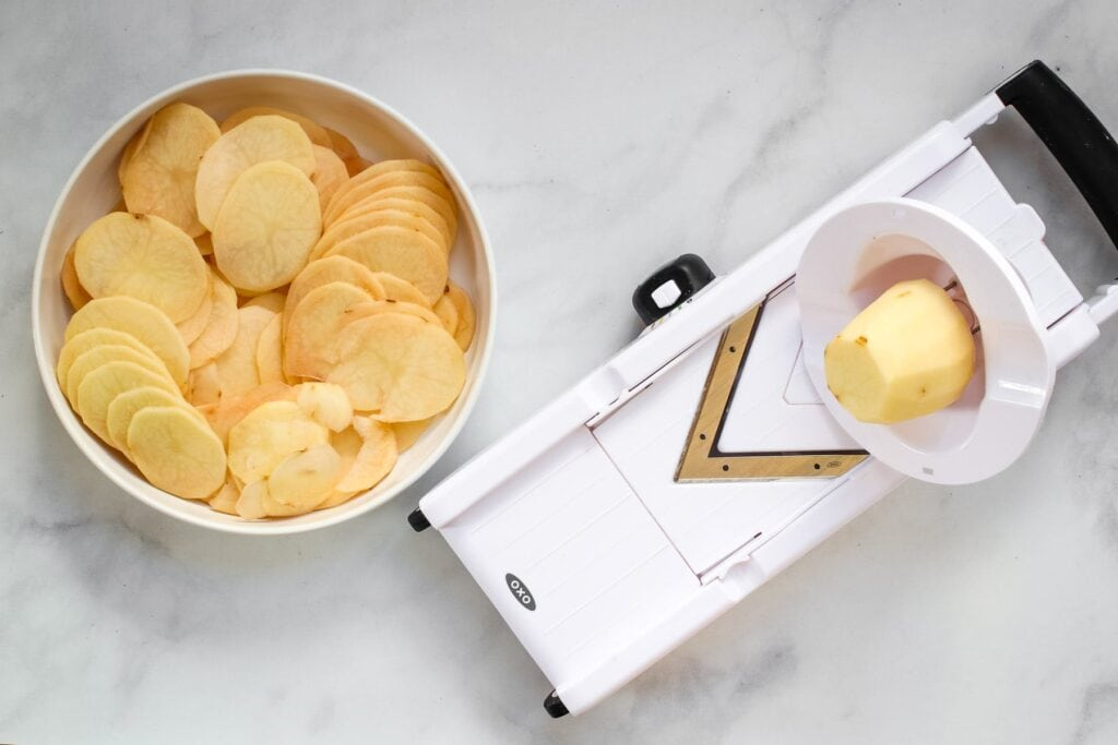 mandoline slicing potatoes