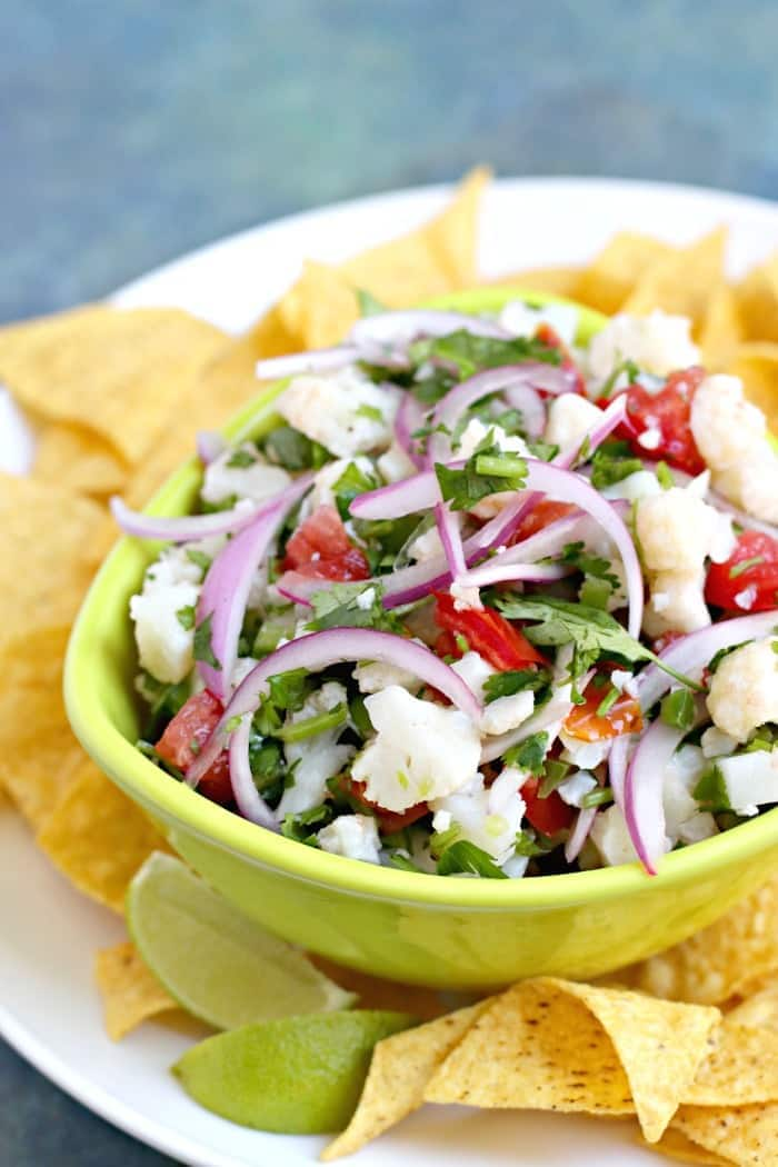 Cauliflower Ceviche in green bowl with tortilla chips