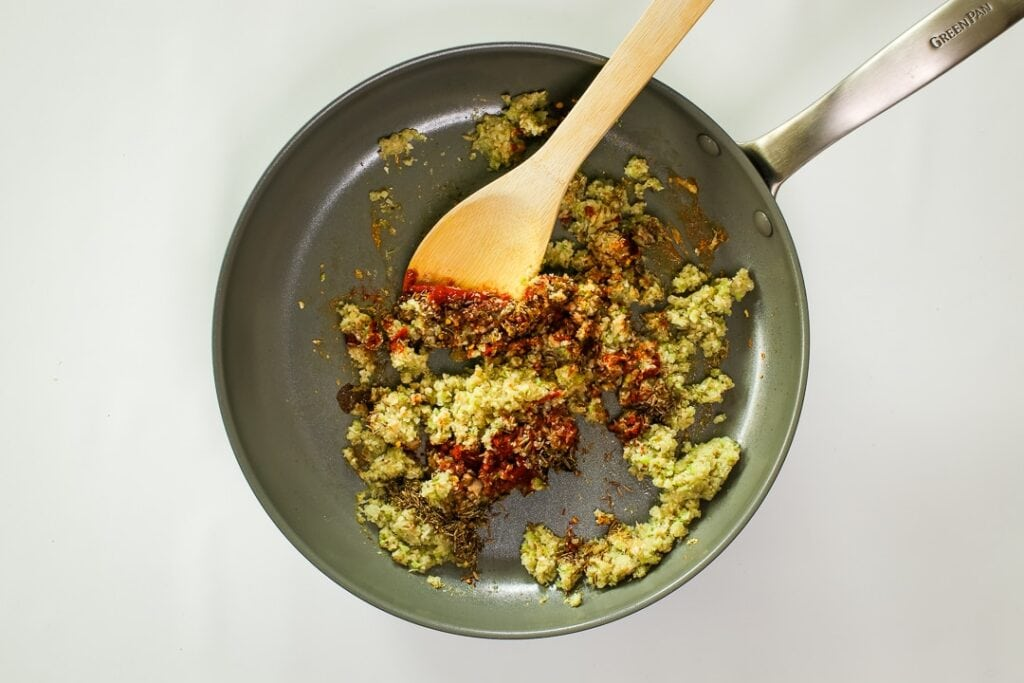 Add the spices to the saute pan.