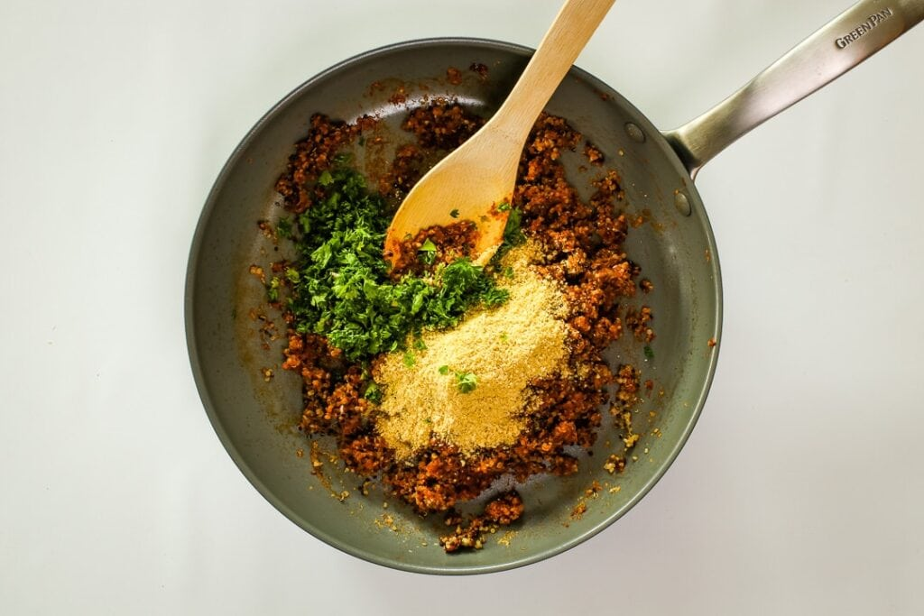 Remove from heat, and add the vegan Parmesan and parsley.