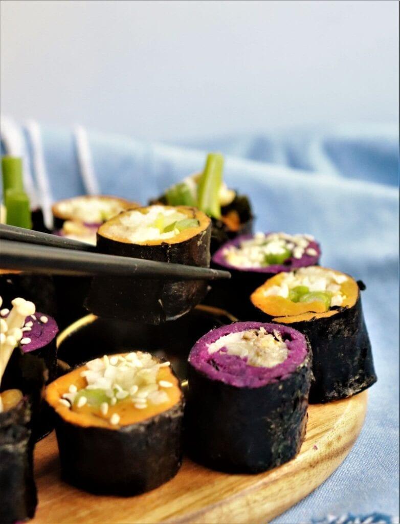 No Rice Sushi with Sweet Potato & Jicama on cutting board with chop sticks