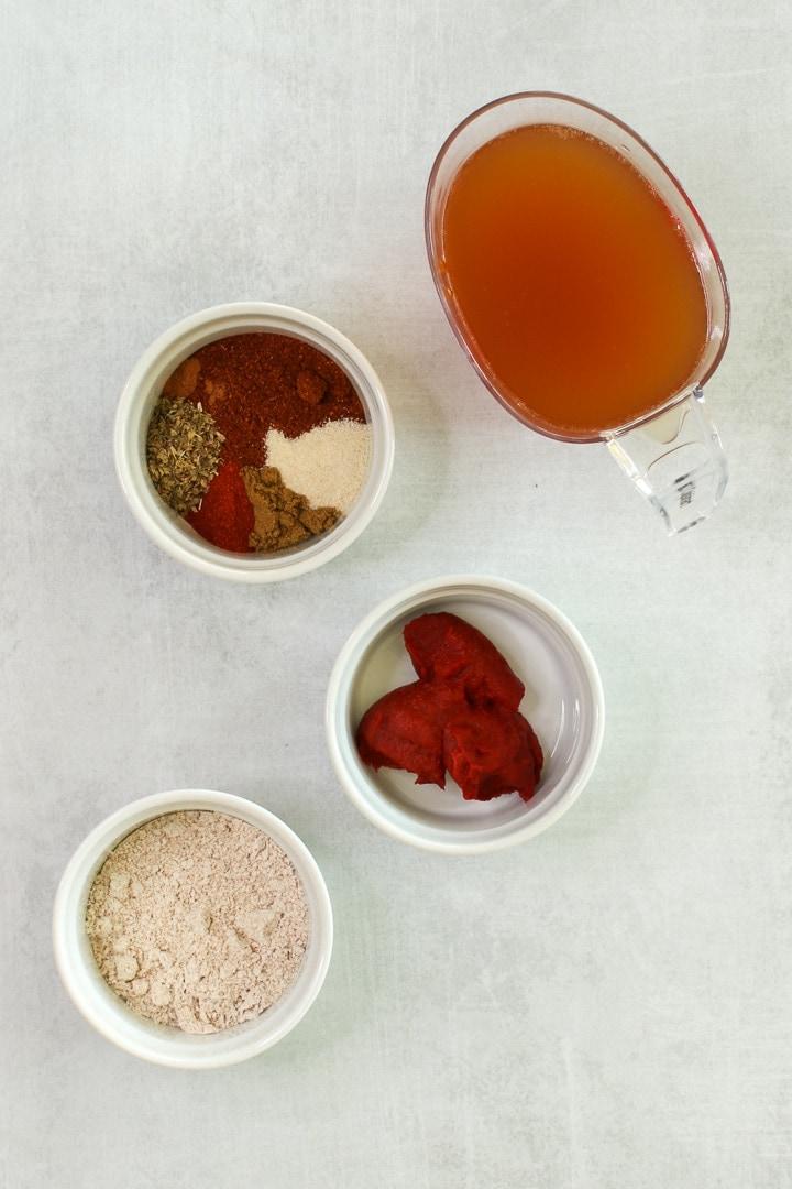 Ingredients: flour, chili powder, onion powder, oregano, cumin, garlic powder, optional smoked paprika & cayenne, tomato paste, veggie broth.
