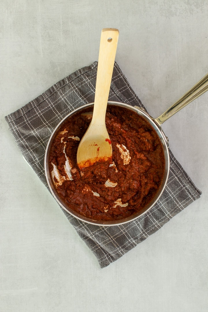 Add flour & spices to hot tomato paste in a sauce pan and stir to combine.