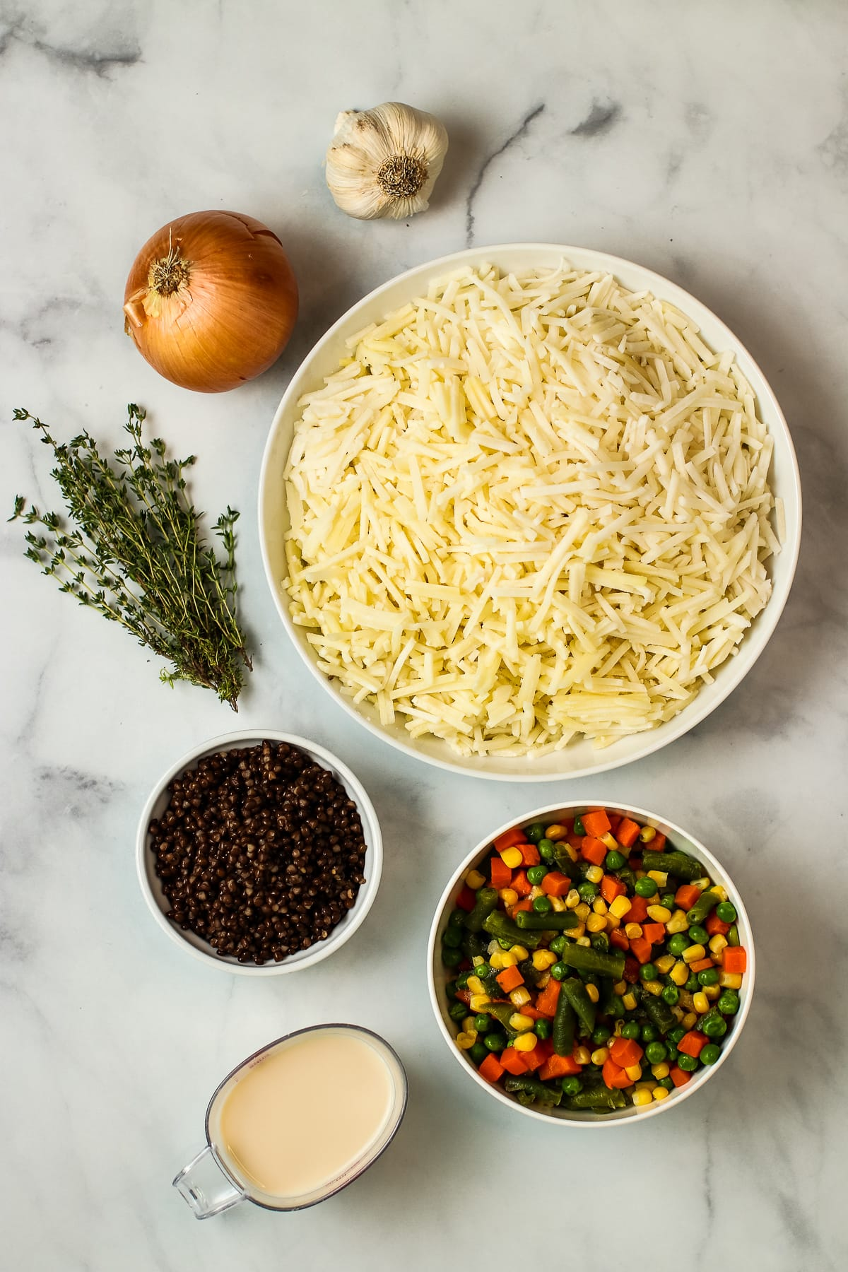 Ingredients: hash brown potatoes, mixed vegetables, lentils, onion, garlic, thyme, plant milk.